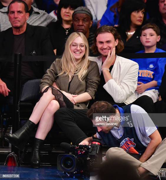 Dakota Fanning and guest attend Detroit Pistons Vs New York Knicks game at Madison Square Garden on October 21 2017 in New York City