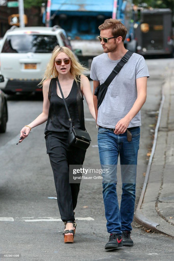 Dakota Fanning and Jamie Strachan are seen in New York on July 30, 2014 in New York City.