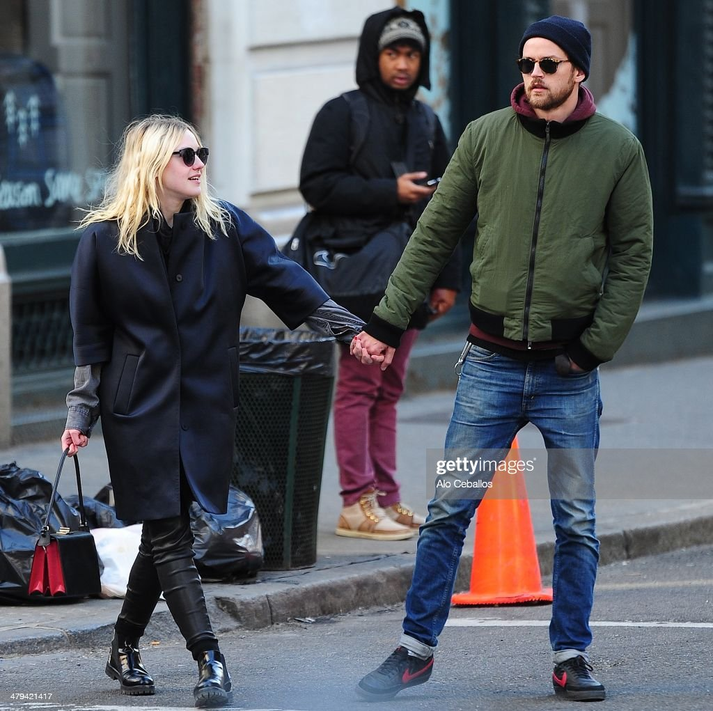 Dakota Fanning and Jamie Strachan are seen in Soho on March 18, 2014 in New York City.