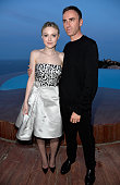 Dakota Fanning and Raf Simons attend the Dior Croisiere 2016 at Palais Bulle on May 11 2015 in Theoule sur Mer France