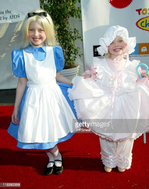 Dakota Fanning and sister during The 9th Annual 'Dream Halloween Los Angeles' Benefits The Children Affected By AIDS Foundation at Barker Hanger in...