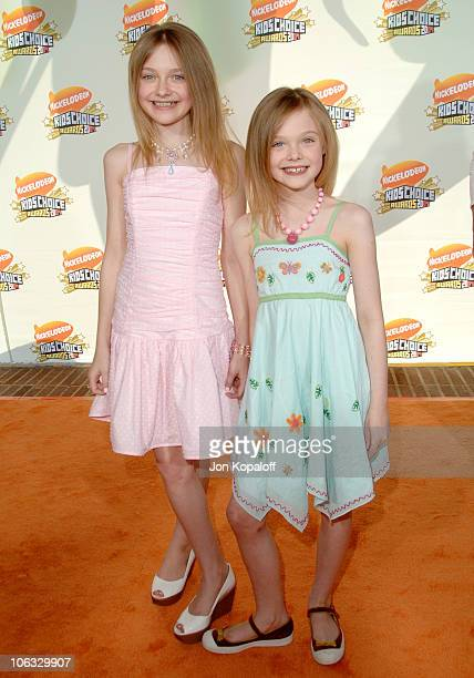 Dakota Fanning and sister Elle Fanning during Nickelodeon's 20th Annual Kids' Choice Awards Arrivals at Pauley Pavilion UCLA in Westwood California...