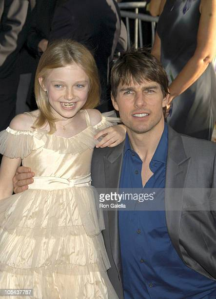 Dakota Fanning and Tom Cruise during 'War of the Worlds' New York City Premiere Outside Arrivals at Ziegfeld Theatre in New York City New York United...