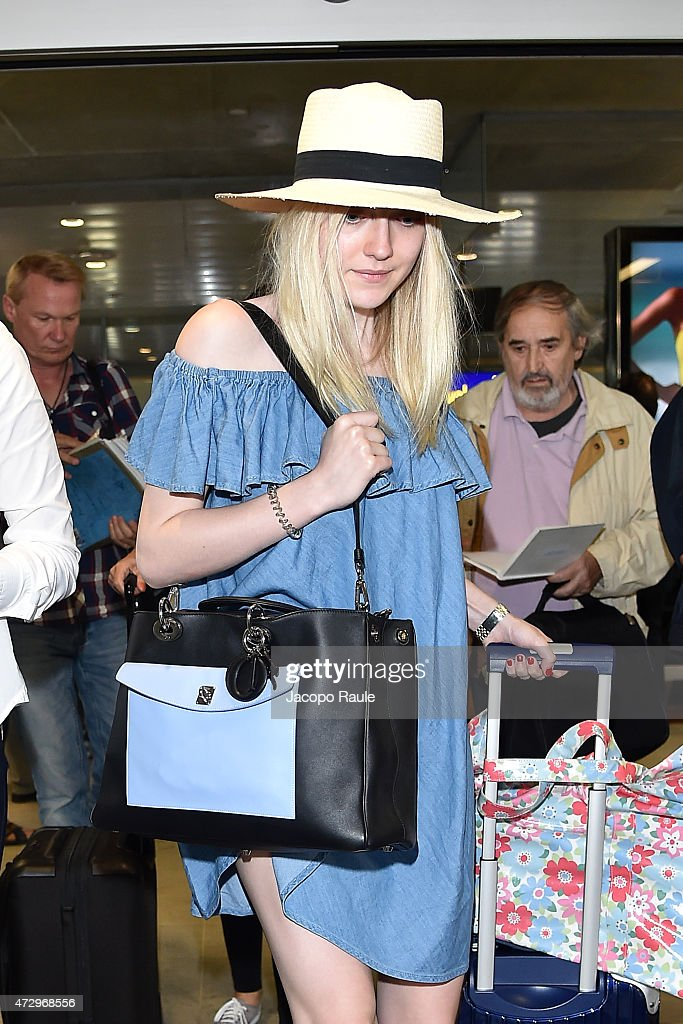 Dakota Fanning arrives at Nice Airport during the 68th annual Cannes Film Festival on May 11 2015 in Cannes France