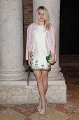 Dakota Fanning attends Miu Miu Women's Tales Dinner at Ca Corner della Regina on August 28 2014 in Venice Italy