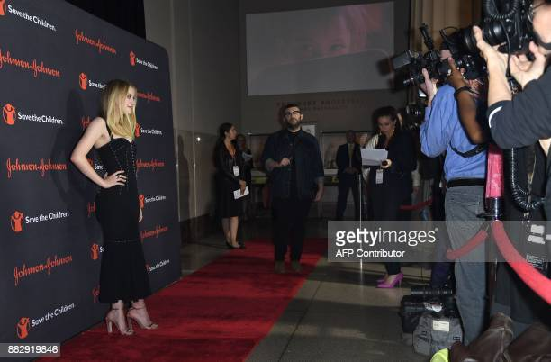 Dakota Fanning attends the 5th Annual Save The Children Illumination Gala at The American History Museum on October 18 2017 in New York City / AFP...