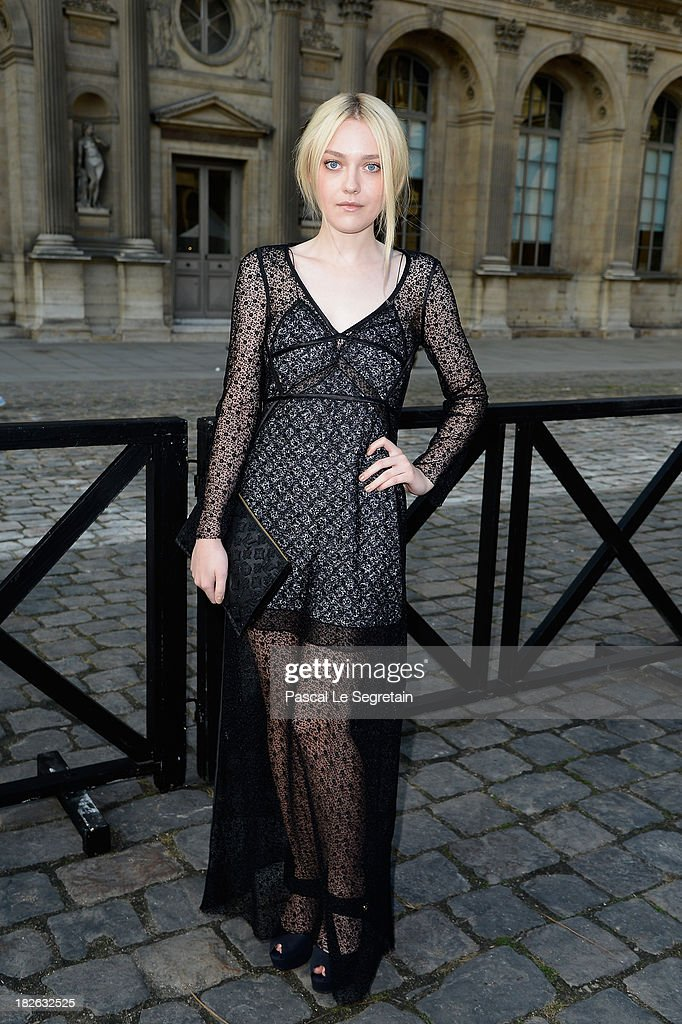 Dakota Fanning attends the Louis Vuitton show as part of the Paris Fashion Week Womenswear Spring/Summer 2014 at Le Carre du Louvre on October 2, 2013 in Paris, France.