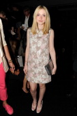 Dakota Fanning attends the Marc Jacobs Collection Spring 2012 Front Row at NY State Armory on September 15 2011 in New York City