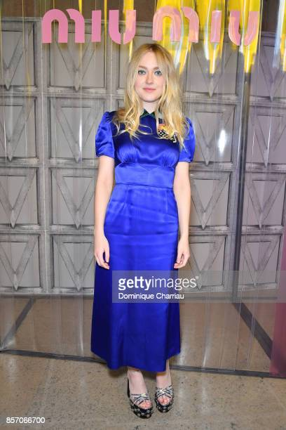 Dakota Fanning attends the Miu Miu show as part of the Paris Fashion Week Womenswear Spring/Summer 2018 on October 3 2017 in Paris France
