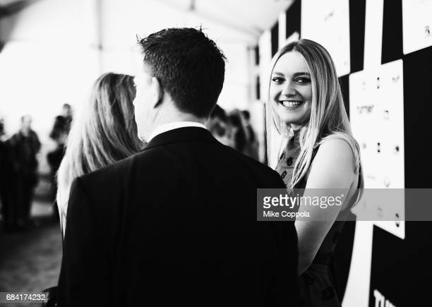 Dakota Fanning attends the Turner Upfront 2017 arrivals on the red carpet at The Theater at Madison Square Garden on May 17 2017 in New York City...