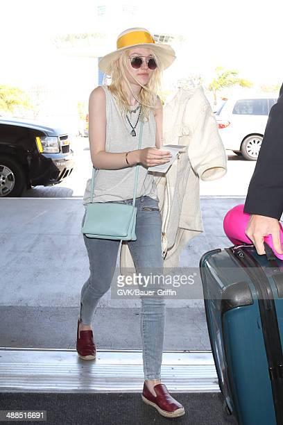 Dakota Fanning seen at LAX on May 06 2014 in Los Angeles California