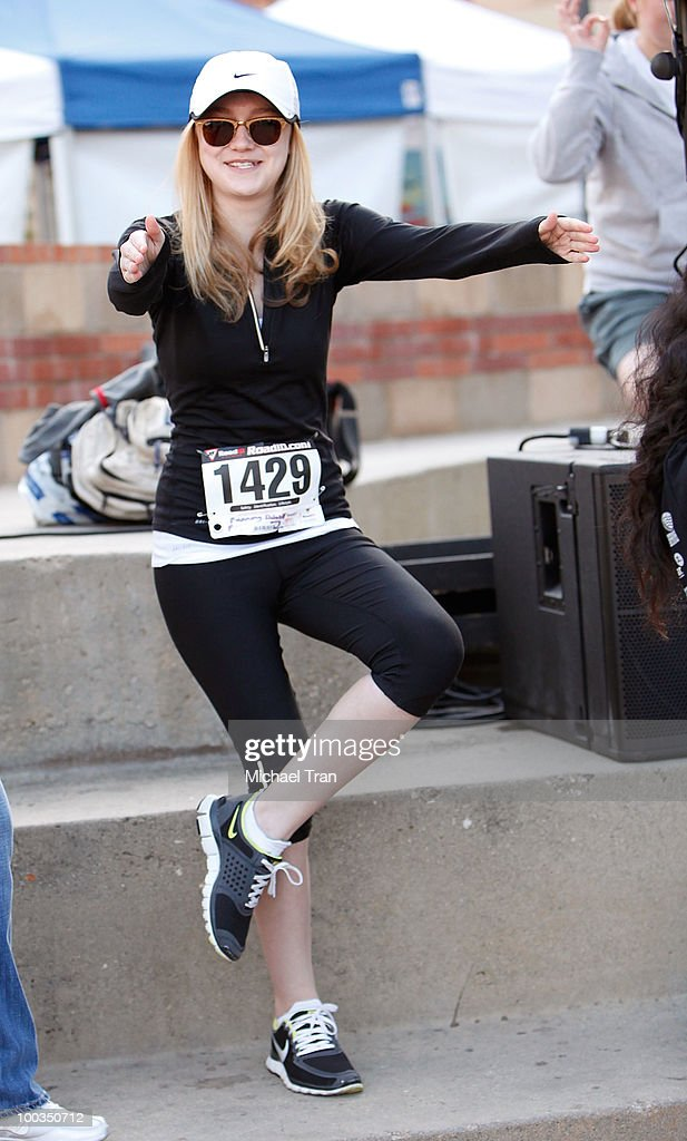 Dakota Fanning warms up for the 11th Annual 5K Mattel Children's Hospital UCLA Benefit held at UCLA Campus on May 23, 2010 in Westwood, California.