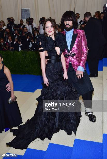 Dakota Johnson and Alessandro Michele arrive at 'Rei Kawakubo/Comme des Garcons Art Of The InBetween' Costume Institute Gala at The Metropolitan...