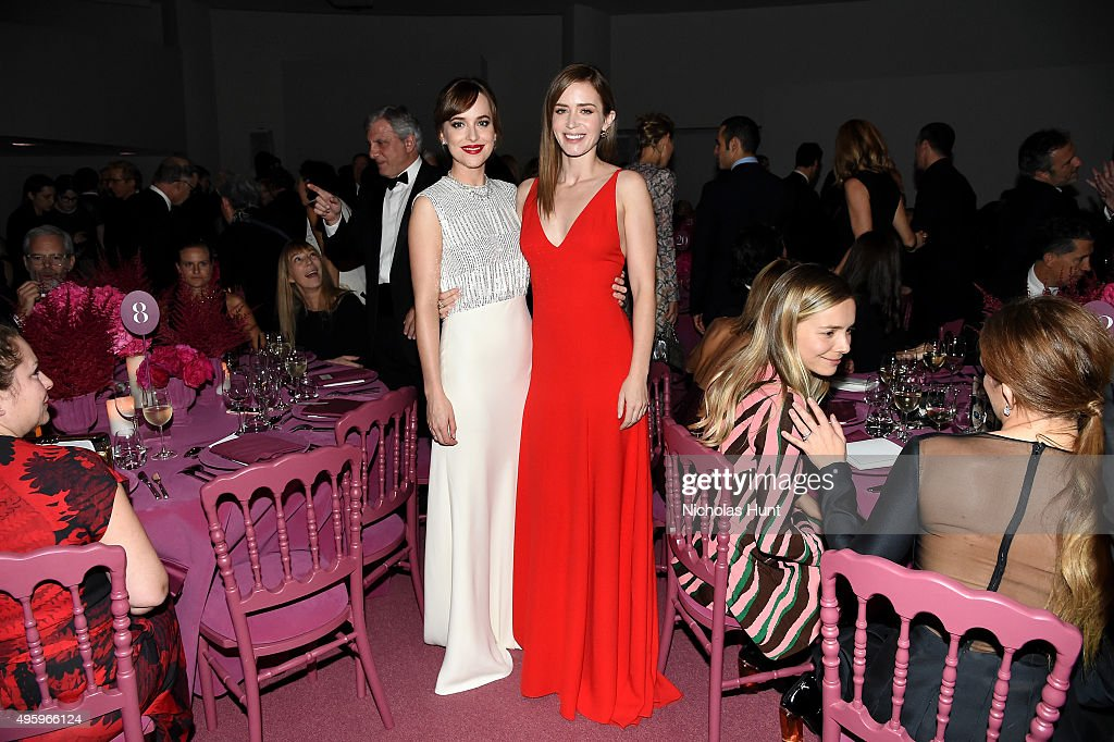 Dakota Johnson (L) and Emily Blunt attend the 2015 Guggenheim International Gala Dinner made possible by Dior at Solomon R. Guggenheim Museum on November 5, 2015 in New York City.
