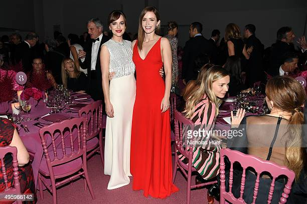 Dakota Johnson and Emily Blunt attend the 2015 Guggenheim International Gala Dinner made possible by Dior at Solomon R Guggenheim Museum on November...