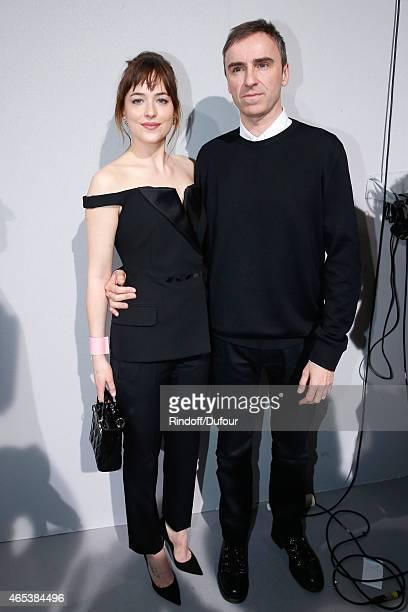 Dakota Johnson and Fashion Designer Raf Simons pose backstage after the Christian Dior show as part of the Paris Fashion Week Womenswear Fall/Winter...