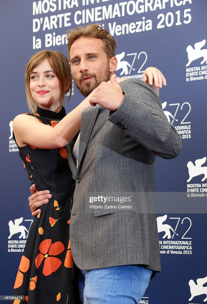 Dakota Johnson and Matthias Schoenaerts attend a photocall for 'A Bigger Splash' during the 72nd Venice Film Festival at Palazzo del Casino on September 6, 2015 in Venice, Italy.