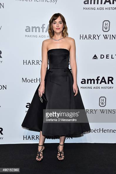 Dakota Johnson arrives at amfAR Milano 2015 at La Permanente on September 26 2015 in Milan Italy