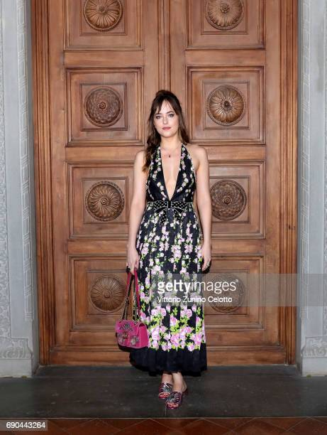 Dakota Johnson arrives at the Gucci Cruise 2018 fashion show at Palazzo Pitti on May 29 2017 in Florence Italy