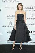 Dakota Johnson attends amfAR Milano 2015 at La Permanente on September 26 2015 in Milan Italy
