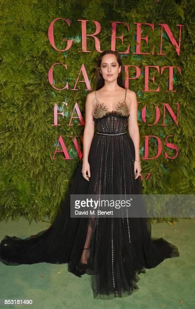 Dakota Johnson attends the Green Carpet Fashion Awards Italia wearing Gucci for the Green Carpet Challenge at Teatro Alla Scala on September 24 2017...