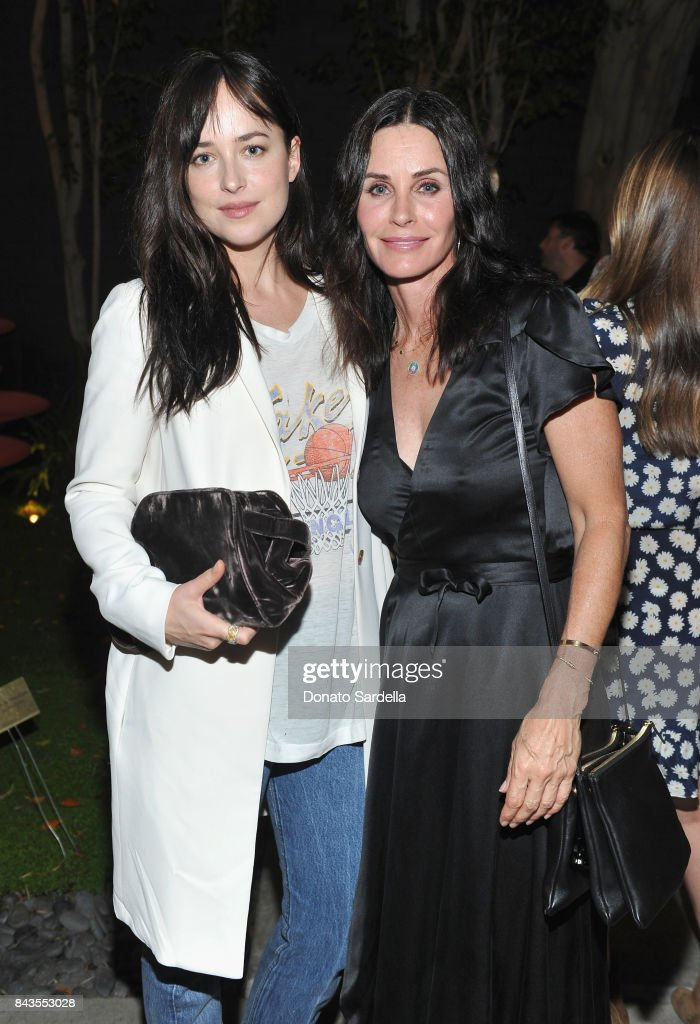 "Dakota Johnson, Courteney Cox and celebrity floral and fragrance designer Eric Buterbaugh attend the private opening of Sascha von Bismarck debut photography collection, ""PERFUME,"" at Eric Buterbaugh Gallery on September 6, 2017 in Los Angeles, California."