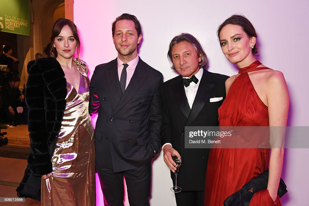 <a gi-track='captionPersonalityLinkClicked' href=/galleries/search?phrase=Dakota+Johnson&family=editorial&specificpeople=2091563 ng-click='$event.stopPropagation()'>Dakota Johnson</a>, <a gi-track='captionPersonalityLinkClicked' href=/galleries/search?phrase=Derek+Blasberg&family=editorial&specificpeople=856710 ng-click='$event.stopPropagation()'>Derek Blasberg</a>, Leon Max and Yana Max attend a private view of 'Vogue 100: A Century of Style' hosted by Alexandra Shulman and Leon Max at the National Portrait Gallery on February 9, 2016 in London, England.