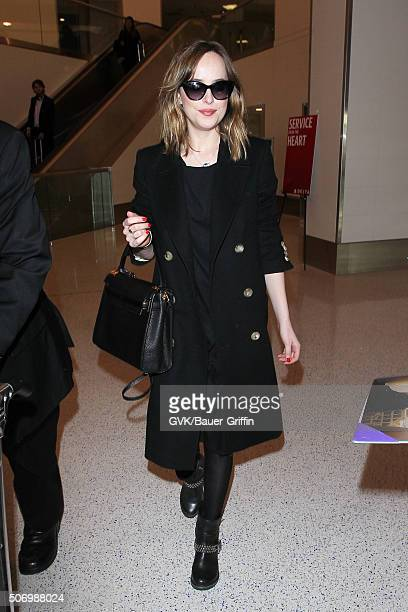 Dakota Johnson is seen at LAX on January 26 2016 in Los Angeles California