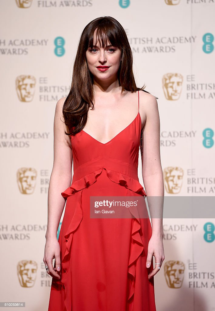 <a gi-track='captionPersonalityLinkClicked' href=/galleries/search?phrase=Dakota+Johnson&family=editorial&specificpeople=2091563 ng-click='$event.stopPropagation()'>Dakota Johnson</a> poses in the winners room at the EE British Academy Film Awards at the Royal Opera House on February 14, 2016 in London, England.