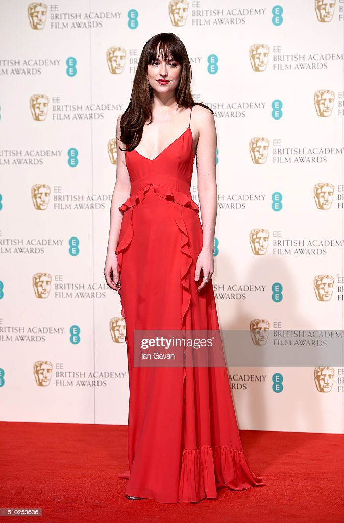 Dakota Johnson poses in the winners room at the EE British Academy Film Awards at the Royal Opera House on February 14 2016 in London England