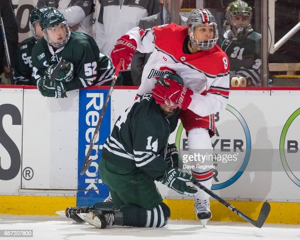 Dakota Joshua of the Ohio State Buckeyes battles along the boards with Dylan Pavelek of the Michigan State Spartans during game one of the Big Ten...
