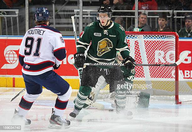 Dakota Mermis of the London Knights gets set to defend against Nick Moutrey of the Saginaw Spirit in an OHL game on January 4 2013 at the Budweiser...