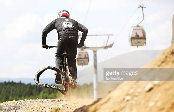 Dakotah Norton of United States loses a tire in the Men's Downhill at the UCI Mountain Bike World Cup on June 5 2016 in Fort William Scotland