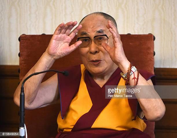 Dalai Lama gestures during a meeting with the Milan Archibishop Angelo Scola on October 20 2016 in Milan Italy The Dalai Lama spiritual leader of...