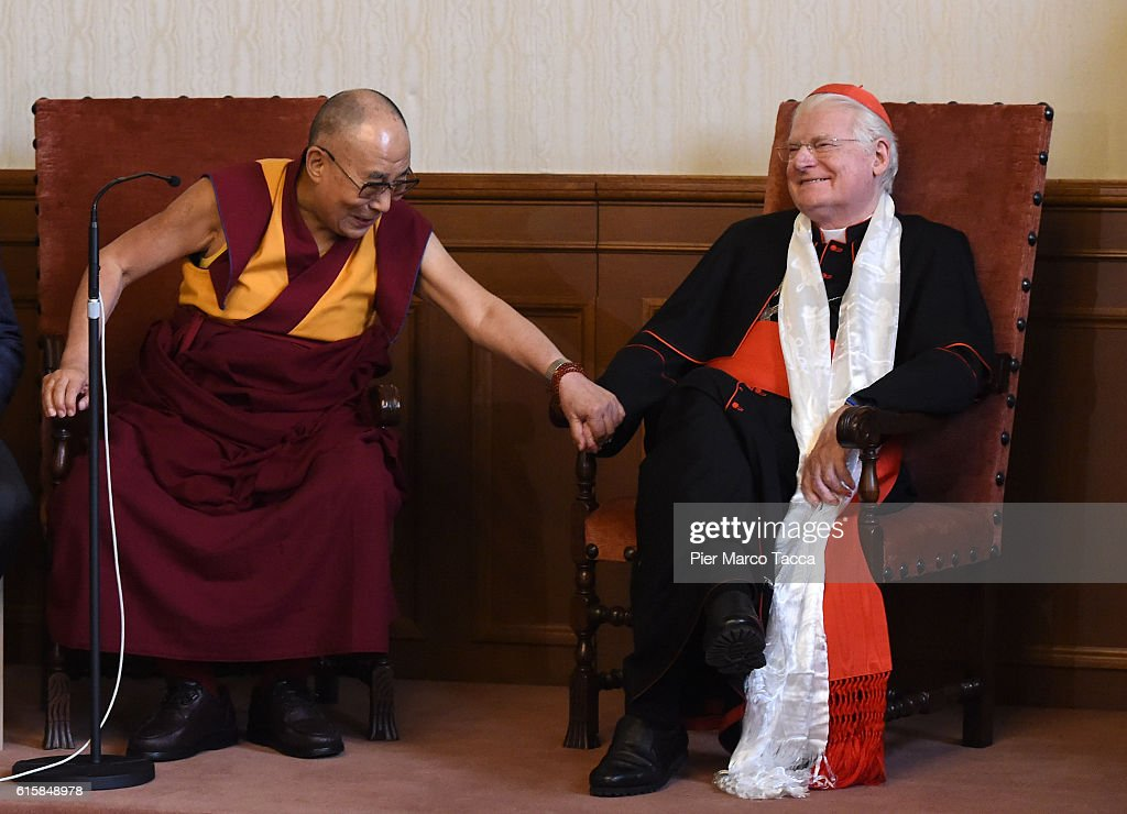 Dalai Lama gestures with Milan Archibishop Angelo Scola during a meeting with the Archbishop on October 20, 2016 in Milan, Italy. The Dalai Lama spiritual leader of Tibetan Buddhism, begins today the first of a three-day visit and spiritual meetings in Milan.