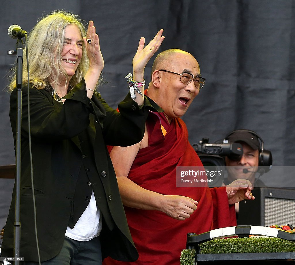 Dalai Lama is given a birthday cake during his a talk on the pyramid stage during <a gi-track='captionPersonalityLinkClicked' href=/galleries/search?phrase=Patti+Smith+-+Godmother+of+Punk&family=editorial&specificpeople=221285 ng-click='$event.stopPropagation()'>Patti Smith</a>'s performance at the Glastonbury Festival at Worthy Farm, Pilton on June 28, 2015 in Glastonbury, England.