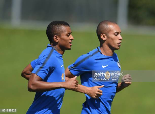 Dalbert Henrique Chagas Estevão and Joao Miranda de Souza Filho of FC Internazionale in action during a training session at Suning Training Center at...