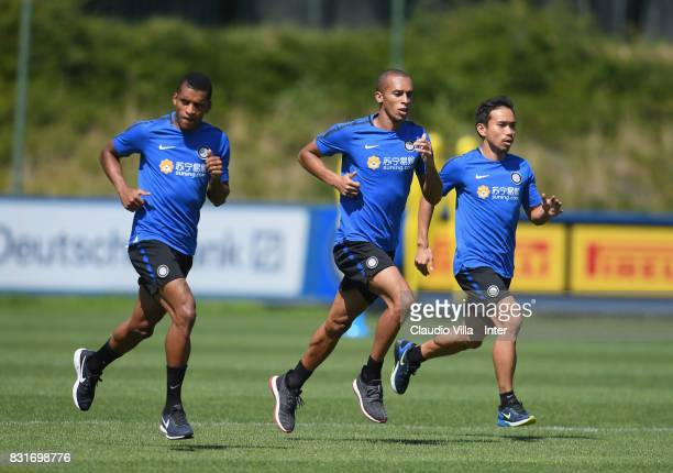 Dalbert Henrique Chagas Estevão Miranda de Souza Filho and Yuto Nagatomo of FC Internazionale in action during a training session at Suning Training...