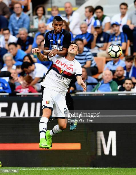 Dalbert Henrique Chagas Estevão of FC Internazionale and Aleandro Rosi of Genoa CFC compete for the ball during the Serie A match between FC...