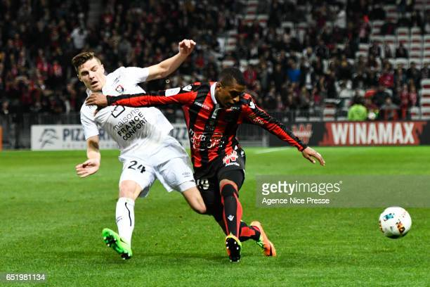 Dalbert Henrique of Nice and Frederic Guilbert of Caen during the Ligue 1 match between OGC Nice and SM Caen at Allianz Riviera on March 10 2017 in...
