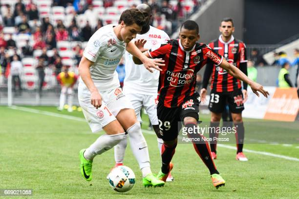 Dalbert Henrique of Nice and Joffrey Cuffaut of Nancy during the Ligue 1 match between OGC Nice and As Nancy Lorraine at Allianz Riviera on April 15...