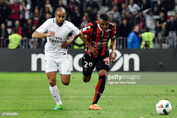 Dalbert Henrique of Nice and Lucas Moura of PSG during the French Ligue 1 match between Nice and Paris Saint Germain at Allianz Riviera on April 30...