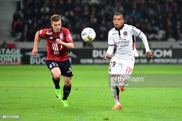 Dalbert Henrique of Nice and Nicolas De Preville of Lille during the French Ligue 1 match between Lille OSC and OGC Nice at Stade PierreMauroy on...