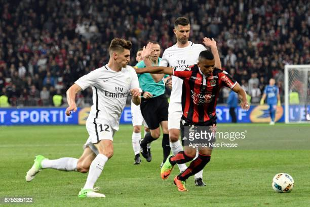 Dalbert Henrique of Nice and Thomas Meunier of PSG during the French Ligue 1 match between Nice and Paris Saint Germain at Allianz Riviera on April...