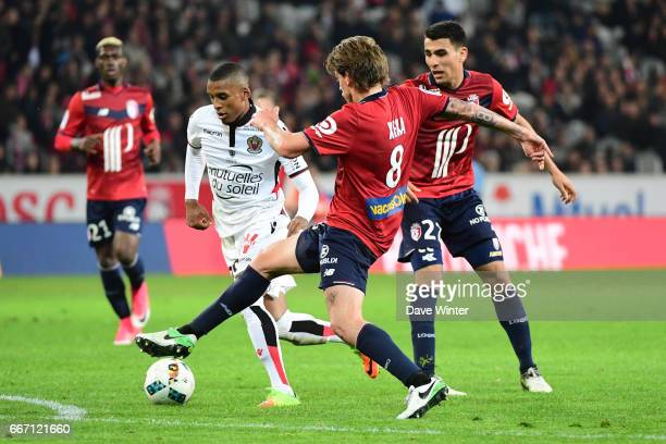 Dalbert Henrique of Nice and Xeka of Lille during the French Ligue 1 match between Lille OSC and OGC Nice at Stade PierreMauroy on April 7 2017 in...