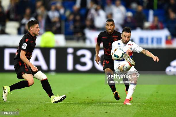 Dalbert Henrique of Nice Mathieu Valbuena of Lyon during the Ligue 1 match between Olympique Lyonnais and OGC Nice at Stade des Lumieres on May 20...