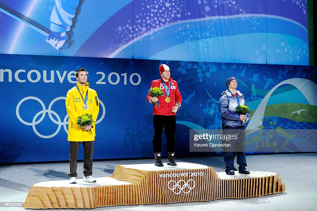 <a gi-track='captionPersonalityLinkClicked' href=/galleries/search?phrase=Dale+Begg-Smith&family=editorial&specificpeople=725004 ng-click='$event.stopPropagation()'>Dale Begg-Smith</a> of Australia celebrates winning silver, <a gi-track='captionPersonalityLinkClicked' href=/galleries/search?phrase=Alexandre+Bilodeau&family=editorial&specificpeople=814666 ng-click='$event.stopPropagation()'>Alexandre Bilodeau</a> of Canada poses with the gold and <a gi-track='captionPersonalityLinkClicked' href=/galleries/search?phrase=Bryon+Wilson&family=editorial&specificpeople=4824254 ng-click='$event.stopPropagation()'>Bryon Wilson</a> of the United States poses with the bronze during the medal ceremony for the Freestyle Skiing Men's Moguls on day 4 of the 2010 Winter Olympics at BC Place on February 15, 2010 in Vancouver, Canada.