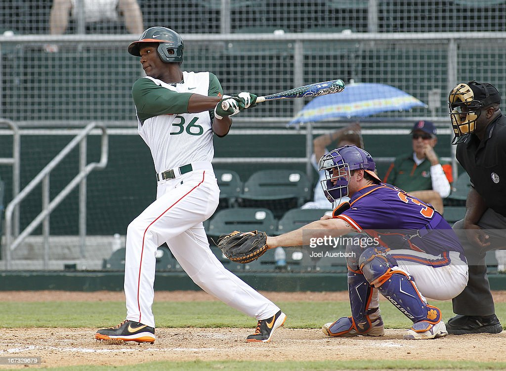 Dale Carey #36 of the Miami Hurricanes hits the ball against the Clemson Tigers on April 21, 2013 at Alex Rodriguez Park at Mark Light Field in Coral Gables, Florida. Miami defeated Clemson 7-0.