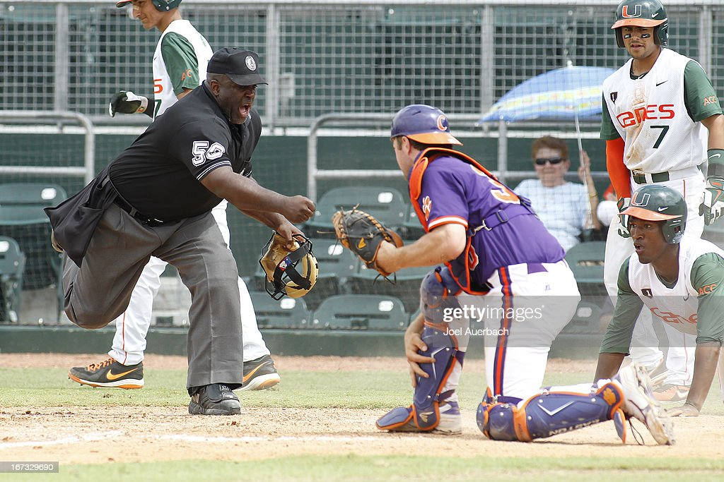 Dale Carey #36 of the Miami Hurricanes looks at home plate umpire Troy Fullwood as he is called out against the Clemson Tigers on April 21, 2013 at Alex Rodriguez Park at Mark Light Field in Coral Gables, Florida. Miami defeated Clemson 7-0.