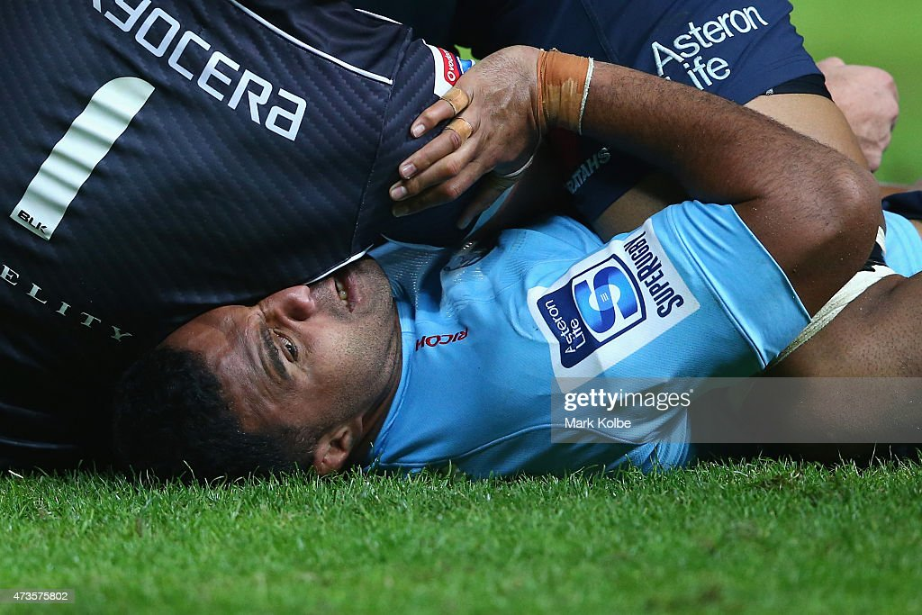 Dale Chadwick of the Sharks lies on the head of Wycliff Palu of the Waratahs during the round 14 Super Rugby match between the Waratahs and the Sharks at Allianz Stadium on May 16, 2015 in Sydney, Australia.
